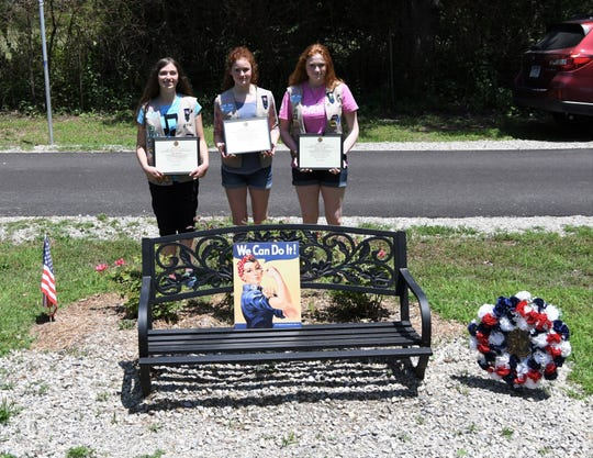 The Joe P. Joslin Jr. American Legion Post 23 of Cotter recently honored the Girls Scouts of Troop 5039 with certificates of appreciation for their work on the Rosie the Riveter Memorial Rose Garden in Cotter's Walnut Hill Cemetery. Girl Scouts working on the rose garden are (from left) Trevi Sheaner, Rachel Chamberlin and Eliseia Faught. Not pictured is Trinity Foster.