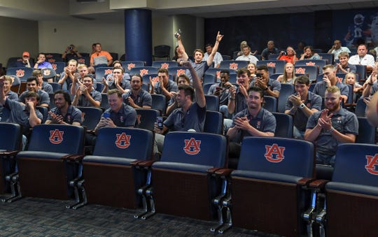 Auburn players celebrate after learning their NCAA Regional destination on Monday, May 27, 2019.