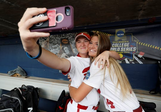 Alabama's Alabama's Kaylee Tow (12) Montana Fouts (14) taking a selfie prior to practice before the team's opening game in the Women's College World Series.