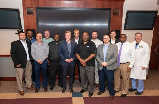 Pictured are part of a group who met for a roundtable discussion with NFL Commissioner Roger Goodell (Front, fourth from left) on safety in the sport. Included in the group were Oakland High coach Kevin Creasy (front, second from left) and Rutherford County Schools Athletic Training Coordinator Brad Rohling (front left).