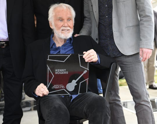 Kenny Rogers shows his marker during the Music City Walk of Fame ceremony at the Walk of Fame Park on Oct. 24, 2017.