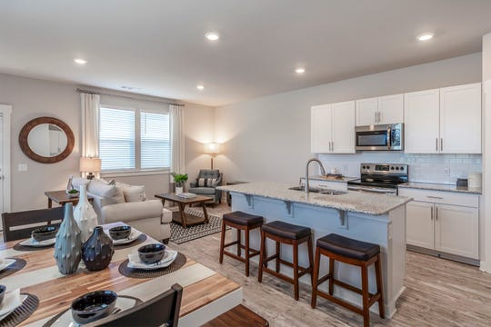 Lennar Homes' model home in the new Preston Park townhome neighborhood in Gallatin has an open floor plan, a kitchen island and wood-look flooring.