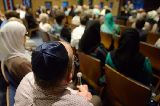 Community members of Jewish and Islamic faiths ask questions during a question and answer session at West End Synagogue on Wednesday, May 29, 2019, in Nashville, Tenn. The synagogue hosted Muslims for an iftar, the breaking of the Ramadan fast.