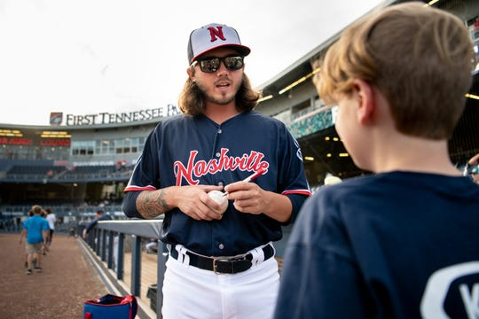 Sounds pitcher Zac Curtis greets Dawson Reynolds, 11, before a game against the Round Rock Express on May 29 at First Tennessee Park.