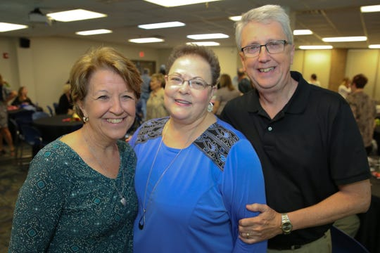 Vol State Community College Financial Aid Director Sue Pedigo with Joni Worsham (Steinhauer) and Phillip Worsham, two graduates of Vol State's first graduating class who worked with Pedigo as students, at Pedigo's retirement party May 9.