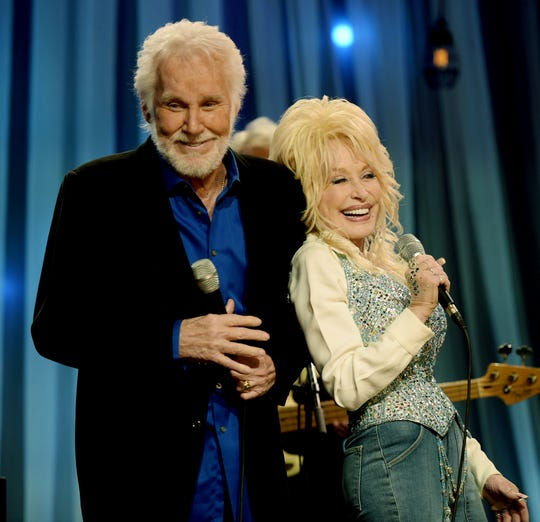 "Kenny Rogers and Dolly Parton share a moment during pre-taping for the ""Dolly Parton's Smoky Mountains Rise: A Benefit for the My People Fund"" Dec. 13, 2016 in Nashville."