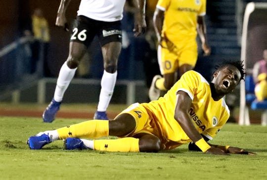 Nashville SC Derrick Jones (4) goes down on the field during the U.S. Open Cup between Nashville SC and Charleston Battery at the Dean A. Hayes Track and Soccer Stadium at MTSU. May 29, 2019.