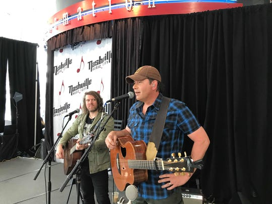 Rodney Atkins performs during the event at the Nashville Visitor Information Center.