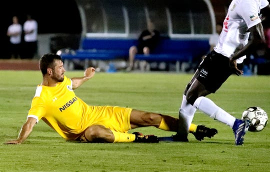 Nashville SC defender Kenneth Tribbett (6) slides to go after the all during the U.S. Open Cup between Nashville SC and  Charleston Battery on Wednesday, May 29, 2019, at the Dean A. Hayes Track and Soccer Stadium at MTSU.