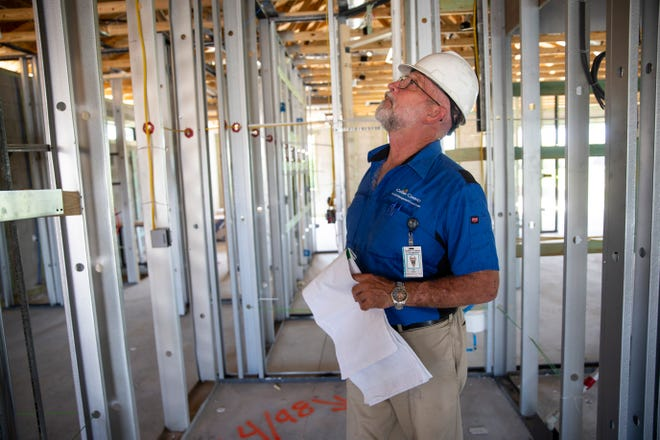 Structural building inspector Tim Stick conducts a framing inspection on the site of a new home on Winding Cypress Drive in Naples on Thursday, May 30, 2019.