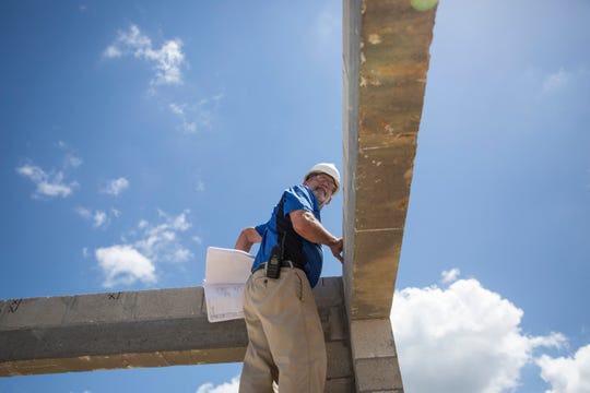 Structural building inspector Tim Stick conducts a lintel beam and fill cell inspection on the site of a new home on Winding Cypress Drive in Naples on Thursday, May 30, 2019. Stick has been working as a building inspector for almost 27 years.