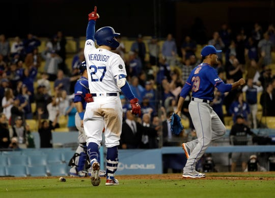 Los Angeles Dodgers' Alex Verdugo (27) watches his sacrifice fly ball which drove in the game winning run next to New York Mets relief pitcher Edwin Diaz during the ninth inning of a baseball game against New York Mets Wednesday, May 29, 2019, in Los Angeles. Los Angeles won 9-8.