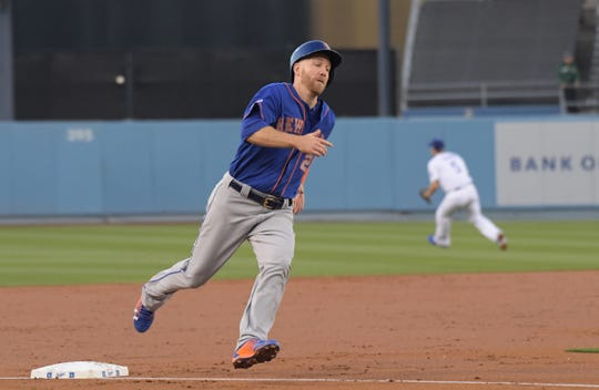 May 29, 2019; Los Angeles, CA, USA; New York Mets third baseman Todd Frazier (21) rounds third base en route to scoring in the second inning against the Los Angeles Dodgers at Dodger Stadium.