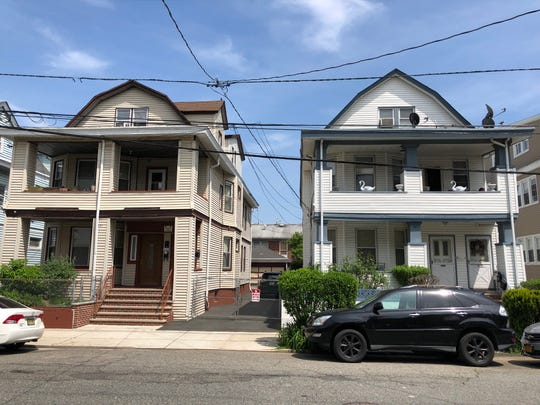 The anarchist bomb that damaged 331 East 31st Street in Paterson, left, in 1919, likely was intended for Harry Klotz, a silk manufacturer who had been a resident of the house to the right, 335 East 31st Street.