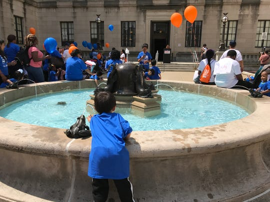 Children, parents and child care workers gather in Trenton Thursday, May 30.