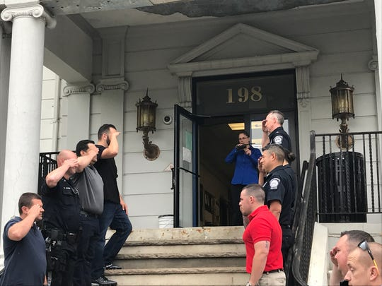 "Bergenfield Police Chief Cathy Madalone does a ""walkout"" of Borough Hall in Bergenfield on May 30, her final day on the job after 25 years."