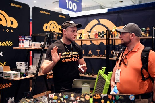 Rockland County native Wayne W., left, procures unique pieces to sell in his Los Angeles store, Dab Nation, and brought some of those pieces to exhibit at Cannabis World Congress and Business Exposition on Thursday, May 30, 2019, in New York.