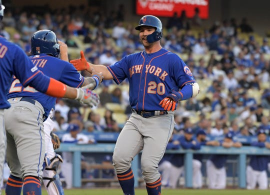 May 29, 2019; Los Angeles, CA, USA; New York Mets first baseman Pete Alonso (20) celebrates with first baseman Dominic Smith (22) after hitting a two-run home run in the first inning against the New York Mets at Dodger Stadium.