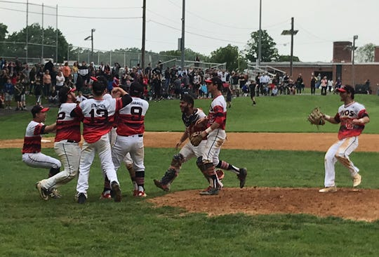 Emerson baseball players celebrate their 5-4 win over Midland Park in the North 1, Group 1 semifinals on Thursday, May 30, 2019.