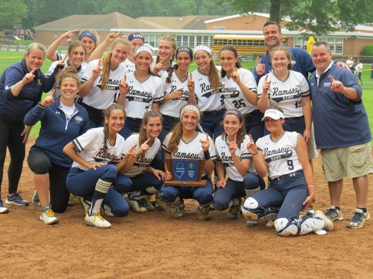Ramsey softball celebrates after three-peating as North 1, Group 2 champion with a 1-0 win over Lenape Valley in Ramsey on Thursday, May 30, 2019.