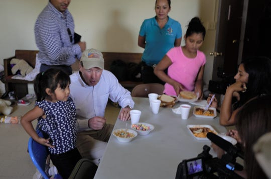 U.S. Sen. Tom Udall, left, D-N.M., speaks with a migrant girl from Guatemala on Thursday, May 30, 2019 at El Calvario United Methodist Church, which serves as a shelter for asylum-seeking immigrants.