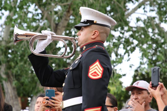 A member of the U.S Marine Corps plays taps after the funeral Mass for state Sen. John Pinto on May 30 at Sacred Heart Cathedral in Gallup.