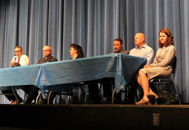 Bloomfield City Attorney Ryan Lane speaks while on stage with City Councilor Curtis Lynch, Mayor Cynthia Atencio, consultant Edwin Reyes, Guzman Energy Managing Director Jeffrey Heit and Guzman Energy attorney Robin Lunt during a meeting on May 29, 2019 at Bloomfield High School.