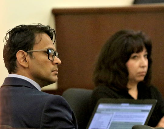 Dr. Alan Emamdee, left, who is accused of six felony counts of criminal sexual penetration and five misdemeanor counts of criminal sexual contact, appeared in in Aztec District Court May 31, 2019.