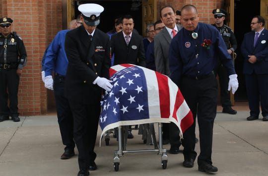 The casket of Navajo Code Talker and state Sen. John Pinto is taken out from Sacred Heart Cathedral on May 30 in Gallup.