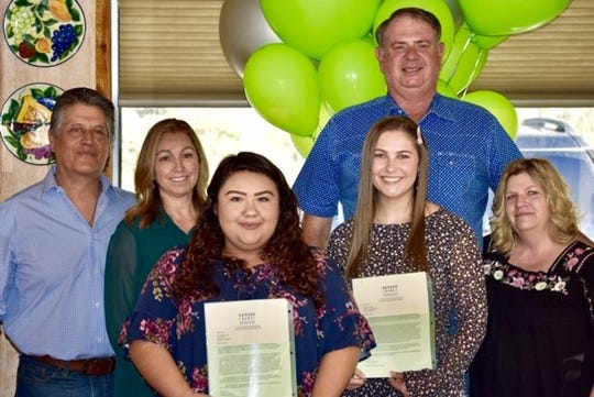 Pictured here are Cesar and Veronica Gomez with Kaelene Chino, at left, and David and Sheri Dawson with Carson Vasile.