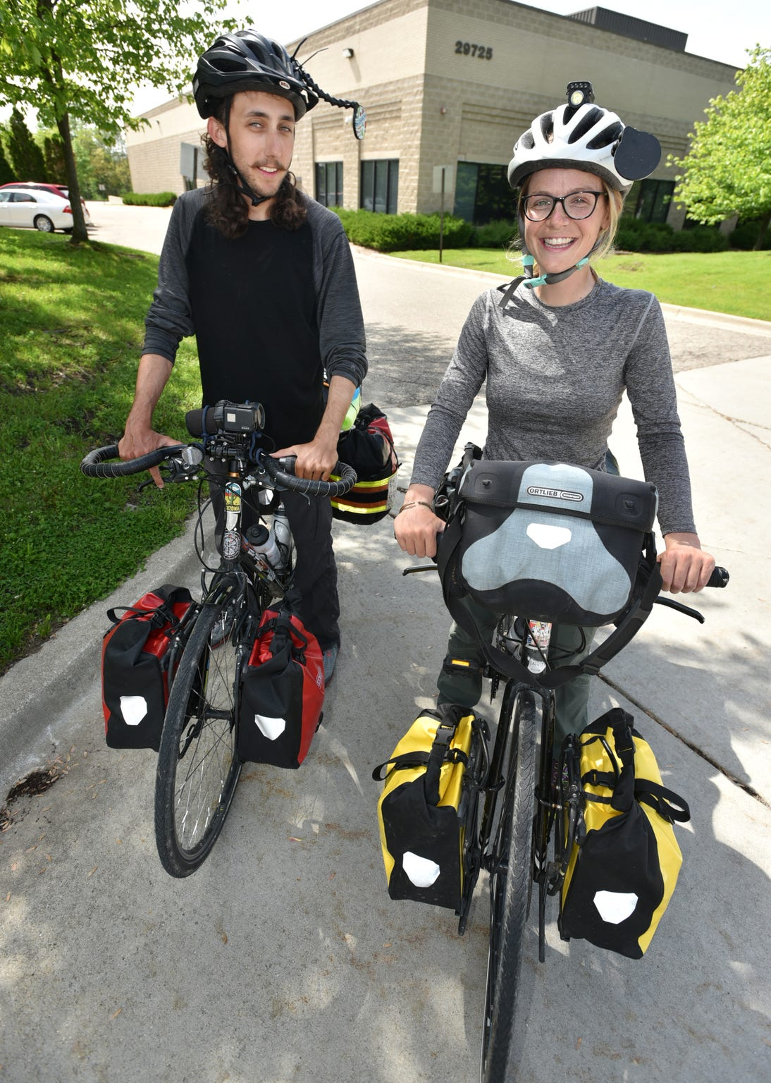 Novi native Lauren Harrington and her boyfriend Daniel Thakur are biking from coast to coast this summer, starting in Maine and ending up in the state of Washington. Here they pause for a moment in their journey near Novi's Beck Road just north of I96.