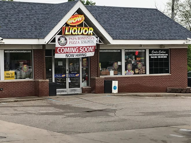 A banner hangs outside the WOW! gas station in Milford where Papa Romano's plans to open. The chain's director of operations said the Milford pizza stand is expected to open in July.