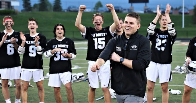 Ray Miller, pictured here last school year after the lacrosse team won the regional championship, was appointed Plymouth High School Athletic Director.