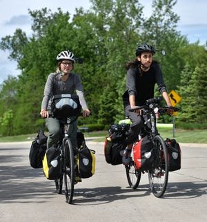 Novi native Lauren Harrington and her boyfriend Daniel Thakur are biking from Maine to the west coast this summer. They stopped in Novi on May 28 to talk with the Novi News.