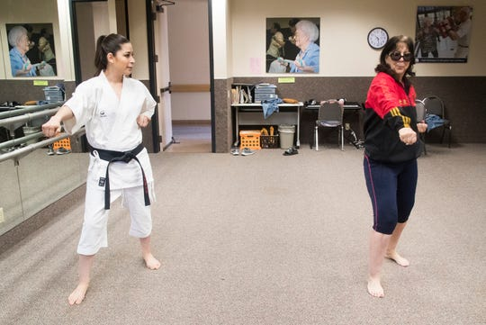 Sensei Tamara Canedo works with her student Cheryl Cervantes during a class at the Braille Institute in its former Rancho Mirage location.