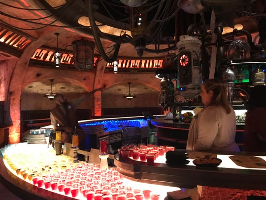 Inside Oga's Cantina, visitors to planet Batuu will find a variety of beverages, including some with alcohol. This is the first time Disneyland has allowed alcoholic beverages to be served anywhere other than a private club. A droid serves as DJ at Oga's. Star Wars: Galaxy's  Edge opens Friday, May 31, 2019, at Disneyland in Anaheim.