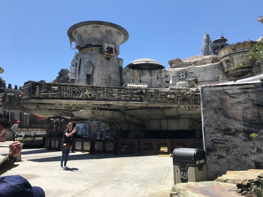 Guests enter Star Wars: Galaxy's Edge at Black Spire Outpost on planet Batuu where a full-size Millennium Force awaits its new crew. Star Wars: Galaxy's  Edge opens Friday, May 31, 2019, at Disneyland in Anaheim.