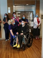 Hospital staff, family, and friends surprise Milton High School senior Luke Taylor with a special graduation ceremony at Sacred Heart Hospital on Saturday, May 25, 2019.  (Photo courtesy of Charissa Houk Cotten)
