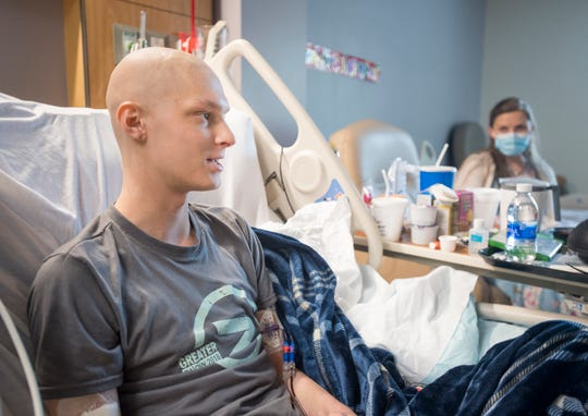 Brandy Taylor, right, listens as her son Luke Taylor talks about his battle with cancer and his high school graduation at Sacred Heart Hospital in Pensacola on Thursday, May 30, 2019.  Since Taylor was unable to attend his graduation from Milton High School,  staff staged a makeshift graduation ceremony for him at the hospital on Saturday, May 25th.