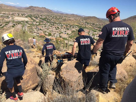 Toby the dog is carried down the mountain by the Peoria Fire Medical rescue team. Toby was lost for five days before he was found on a mountain hungry, dehydrated, bitten and injured.