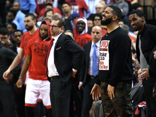 Apr 23, 2019; Toronto, Ontario, CAN;   Recording artist Drake (right) cheers in support of the Toronto Raptors during the second half against the Orlando Magic in game five of the first round of the 2019 NBA Playoffs at Scotiabank Arena. Mandatory Credit: Dan Hamilton-USA TODAY Sports