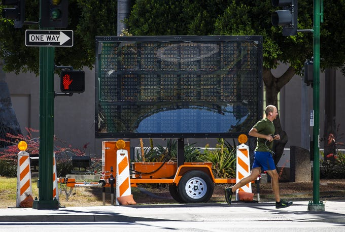 A sign at Central Avenue and Roosevelt Street in downtown Phoenix indicates that the street will be closed on and off for 5 months.