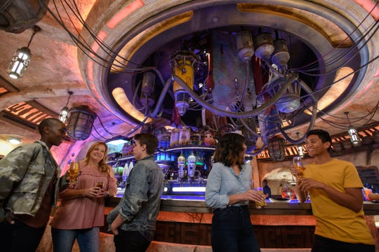 When guests visit Star Wars: Galaxy's Edge at Disneyland Park in Anaheim, California, they'll be able to enjoy Oga's Cantina, a local watering hole to unwind, conduct business and maybe even encounter a friend or a foe. Patrons of the cantina come from across the galaxy to sample the famous concoctions created with exotic ingredients using otherworldly methods, served in unique vessels, with choices for guests of all ages.