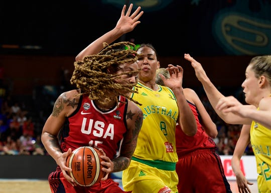 Brittney Griner, left, and Liz Cambage (8) will be dueling again Friday in the Phoenix Mercury season opener Friday. Cambage will be making her debut with the Las Vegas Aces. The centers met last in the 2018 World Cup gold medal game.