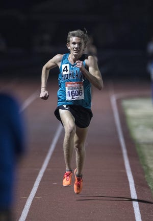 Highland's Leo Daschbach eyes the finish line in the 3200 meters  during the 79th Annual Nike Chandler Rotary Invitational  March 23, 2019.
