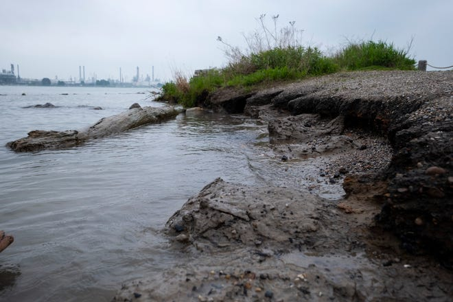 The shoreline along the Blue Water River Walk in Port Huron is seen eroding due to high water levels Thursday, May 30, 2019. The problem is being addressed with an emergency shoreline stabilization, which includes installing natural stone along the shore to act as a wave barrier.