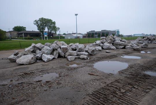 Natural stone will be placed in the St. Clair River along the Blue Water River Walk as part of an emergency shoreline stabilization. The stone will act as a wave barrier to help prevent further erosion of the shoreline.