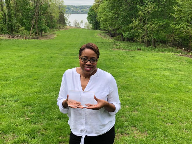 Lesa Cline-Ransome holds the 2019 Rip Van Winkle Award she received from the  School Library Media Specialists of Southeastern NY May 4 for her outstanding contributions to the world of children's literature.