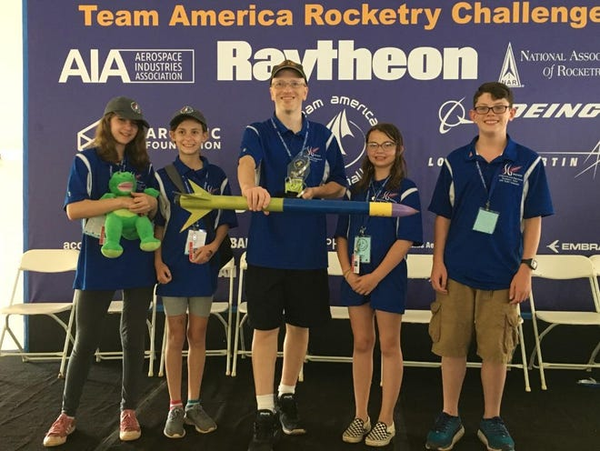 "The Spring Grove Area School District middle school rocketry team placed ninth out of 102 teams at the Team America Rocketry Challenge May 18. Their placement also made them the top team in the northeast. From L to R: Finley Ritenour, Hailey Graff, Brian Hastings (coach), Alyssa Beyer, Alexander ""A.J."" Velez"