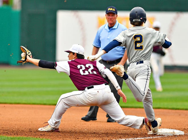 Gettysburg's Josh Topper catches the ball at first to out Cedar Cliff's Trey Law during District III, Class 5-A baseball championship action at PeoplesBank Park in York City, Thursday, May 30, 2019. Dawn J. Sagert photo
